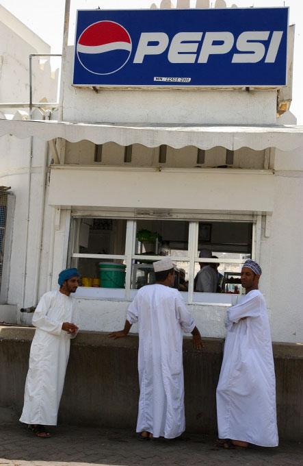 Local Omanis enjoy American Pepsi in Muscat, Oman
