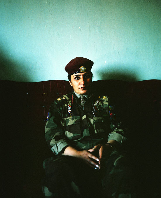 General Khatool Mohamed Zai (she refused to give her age), an Afghan Army paratrooper, sitting in her apartment in the Micrion section of Kabul. Even with nearly 20 years of jumping, she sat in this apartment unemployed during the five years of Taliban rule. Photographed in Kabul, Afghanistan
