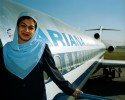 Parwana Ghezel, a 27 year old Ariana Afghan Airlines flight attendant, stands in the doorway of an ex-American Airlines 727 airplane at Kabul Airport in Kabul, Afghanistan