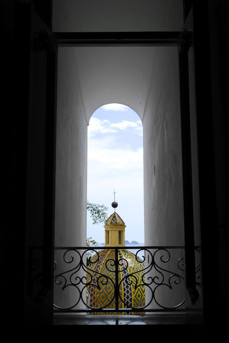 View from a window at Le Sirenuse Hotel in Positano, Italy on the Amalfi Coast.