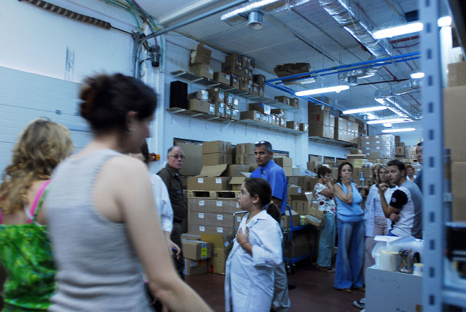 Employees gather in SOFLEX's safe room in Karmiel, Israel on July 19, 2006.