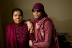 Sabira Manzoor(left), 31, and Iram Saeed (right), 30yrs, both burn victims and survivors, at Iram's mother's house in Rawalpindi, Pakistan on February 12, 2009.  Both women have received educational training and reconstructive surgeries from the Depilex Smile Again NGO.  I   There are presently over 300 cases of burn victims registered in Pakistan.  Most victims are between the ages of 14 - 25 years old.  Motives vary,  but are most frequently obsession, jealousy, suspected infidelity, husband wanting to re-marry, sexual non-cooperation.    The face and genitalia are the areas most generally targeted, those guaranteeing complete disfiguration.