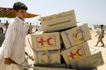 Pakistani refugee with boxes of supplies from the Pakistan Red Crescent at the Swabi IDP camp in Swabi, Pakistan on May 20, 2009.  There are now 1.5 million displaced people in Pakistan's North West.
