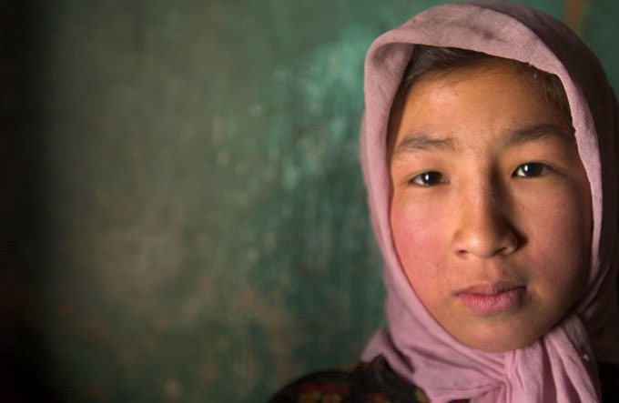 Young Afghan girl in Bamiyan, Afghanistan.  Her mother, Roshan Gul, is a beekeeper and is the main breadwinner in their family.