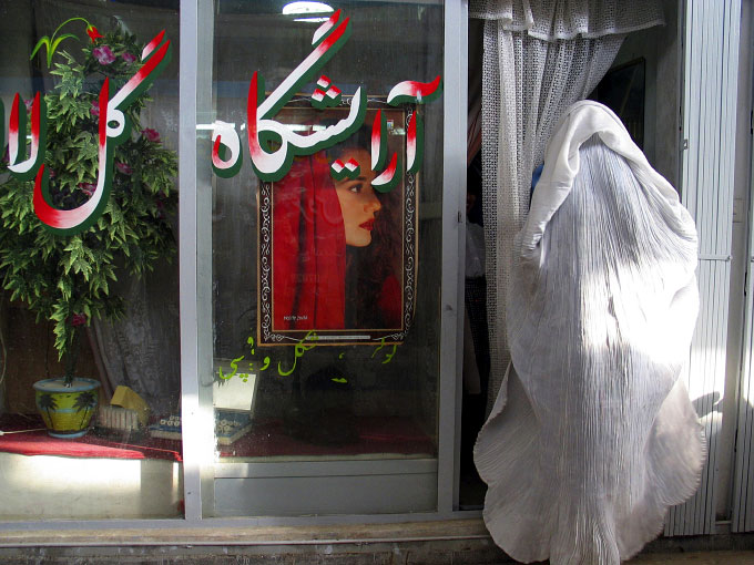 An Afghan bride to be enters one of the many Kabul Beauty salons.