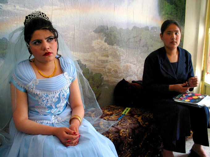 Young Afghan bride to be getting ready for her wedding at one of the local Kabul beauty salons