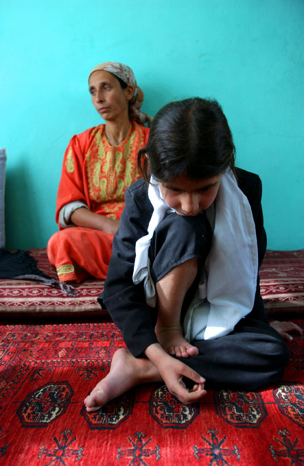 Bubany, 10 years old, became blind at six months. Her mother, Mahjan, sitting behind her, has sent Bubany to a school for blind children in Kabul, Afghanistan. She hopes that one day her daughter will be able to work as a teacher for the blind as well. In Kabul, Afghanistan.