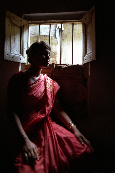 Sex worker at the Sanagachi brothel in Calcutta, India