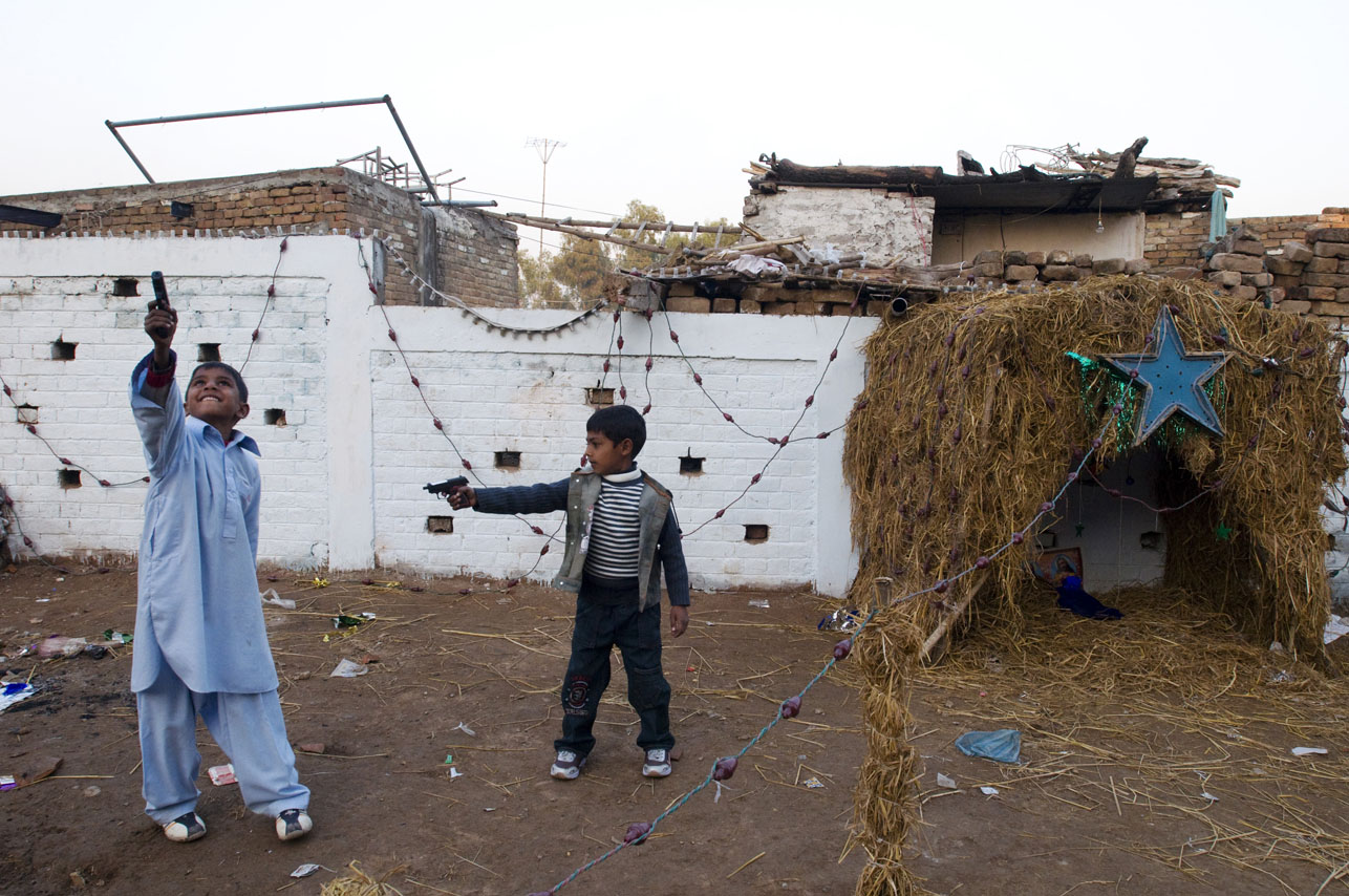 Christian Pakistani children playing with toy guns on Christmas day at a Christian colony in Islamabad, Pakistan.