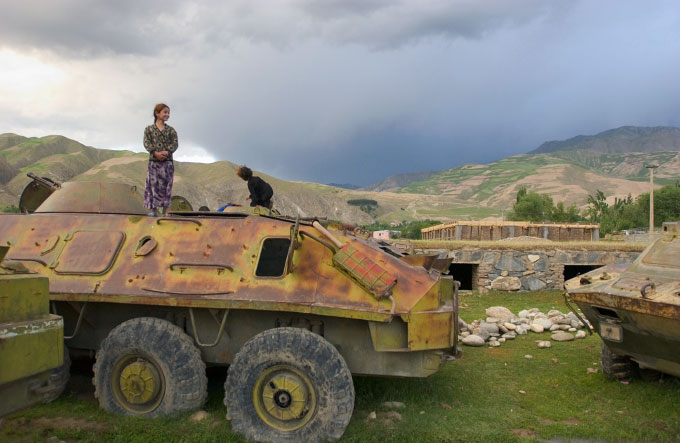 Young Afghan girls playing on an abandoned Soviet tank in Faisabad, Afghanistan. Photographed on June 10, 2005.  Although there has been a large effort to clear Afghanistan of remaining loose weapons they are still littered across the country.
