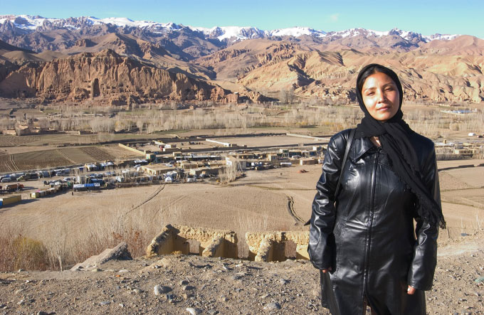 Fatema Kamazamyan, 28 years old, Head of Women's Affairs in Bamiyan, Afghanistan.  Photographed in front of Buddha niches in Bamiyan, Afghanistan.