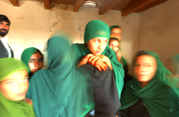 Young Afghan women celebrate at the opening of a new women's center in Assadabad, Afghanistan.