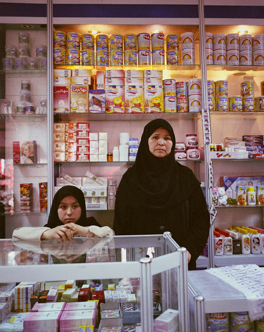 Marzia Tamaski (right) and her daughter, saleswoman at the Herat Supermarket in Herat, Afghanistan.