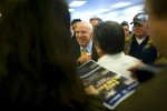 John McCain greets supporters after a town meeting as he campaigns for the Republican presidential nomination.