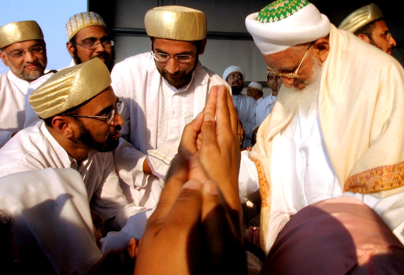 About 200 Dawoodi Bohra members crowded into a hangar at Lawrence Municipal Airport to receive blessings from their spiritual leader, Dr. Burhanuddin.  About one million Shi'ite Muslims belong to the sect, which is based in India and Egypt.