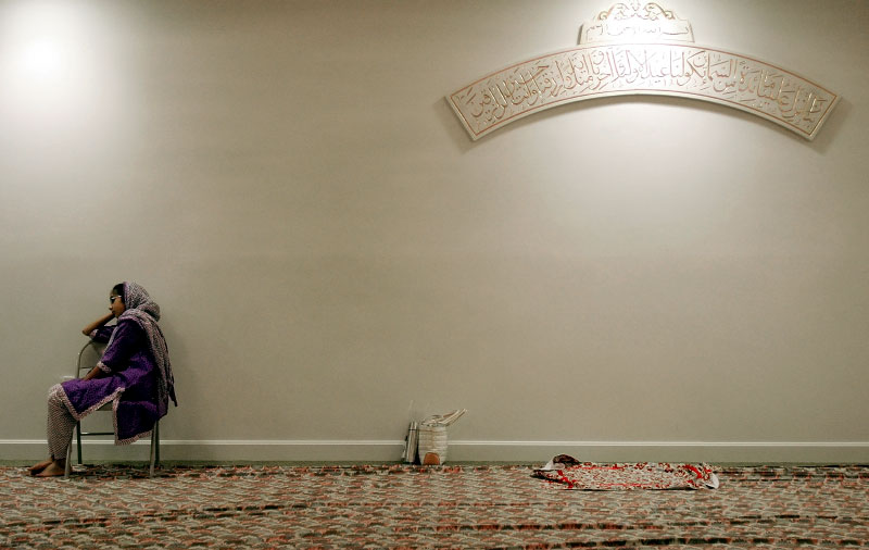 Zainab Doctor, 12, of Andover rests after breaking her fast for Ramadan at the mosque in Billerica.