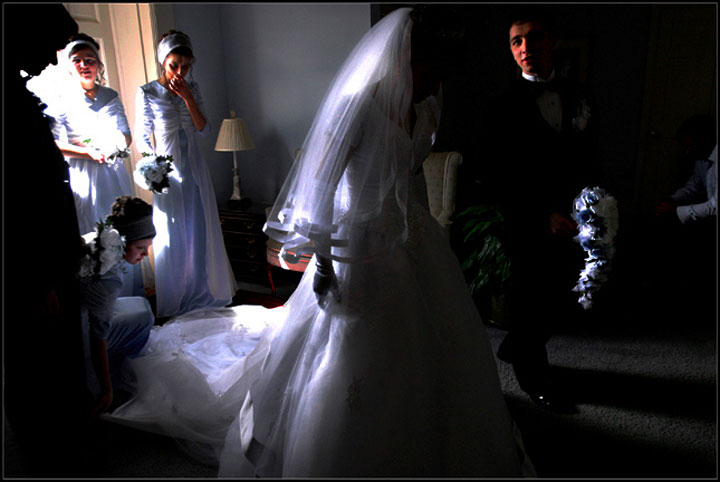 Olga and Mikhail Lebed, her husban-to-be, enter the front doors of the church and prepare to proceed down the aisle at the Cavalry Baptist Church in Asheville, N.C.