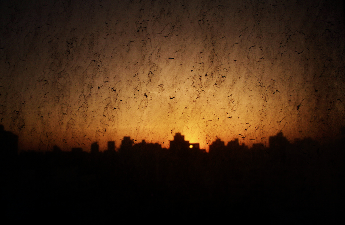 {quote}Sunset Through My Dirty Window{quote} from {quote}In the Shadow of the Pyramids{quote} by Laura El-Tantawy 2005-2014