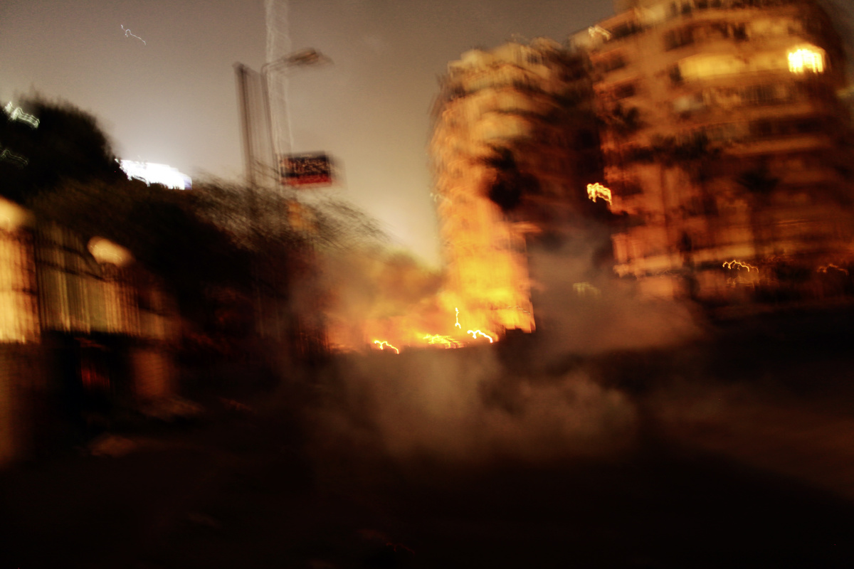 {quote}Clashes Near Tahrir{quote} from {quote}In the Shadow of the Pyramids{quote} by Laura El-Tantawy 2005-2014