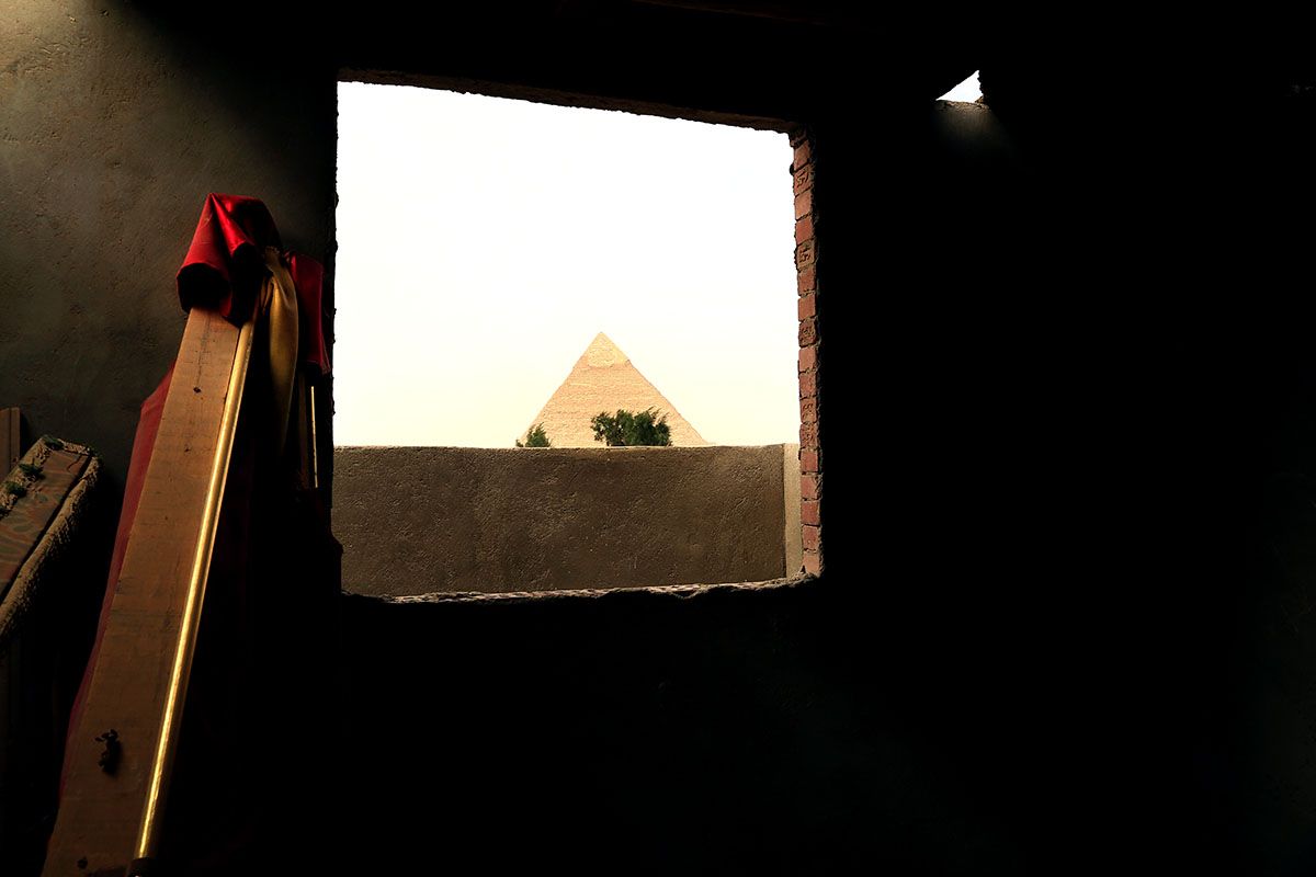 One of the Great Pyramids of Giza is photographed through the window of a house overlooking the ancient icon in the Egyptian capital of Cairo.