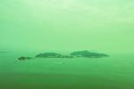A passenger ferry passes by Peng Chau island Hong Kong