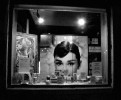 Shop window with Audrey Hepburn photograph.