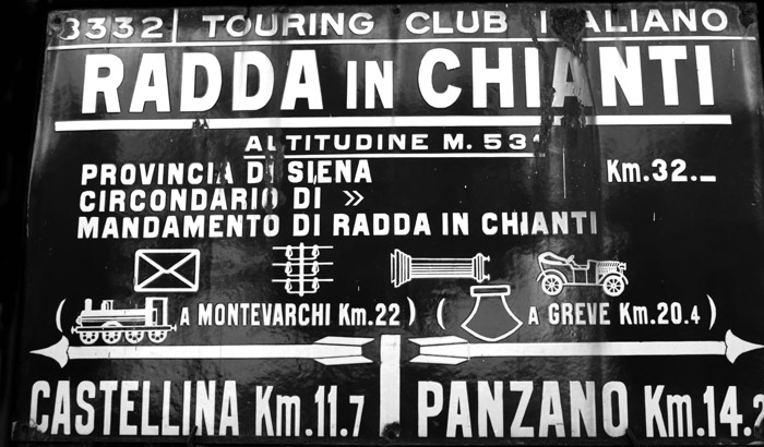 Old metal sign on the side of the road as you drive towards the Chianti region.