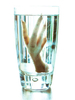Chicken foot in glass of water