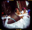 Salsa Aspira dancers of Central High School wait to perform in front of the judges during the Puerto Rican Festival Parade in Philadelphia, PA. 