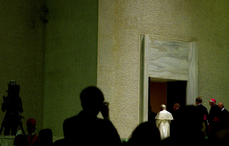 Pope Benedict XVI leaves the Vatican audience hall after blessing the media and guests at the Vatican on Saturday, April 23, 2005.