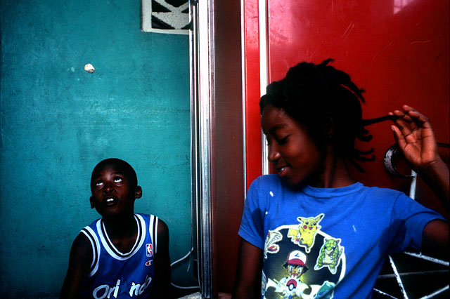 Children play a game similar to Jacks at their home in Petionville. 