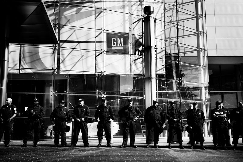 Detroit police stay in In front of GM's headquarter, as people of the People Summit, a four-day protest event, which demands to bail out people, not corporations, wage a protest. June 15, 2009.