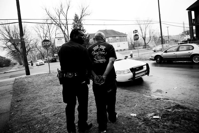 A man, charged of the gun possession and the firing, is arrested in East Detroit where the crime rate has dramatically increased recently, very possibly due to the economic downturn and the high unemployment rate according to Detroit police officers.