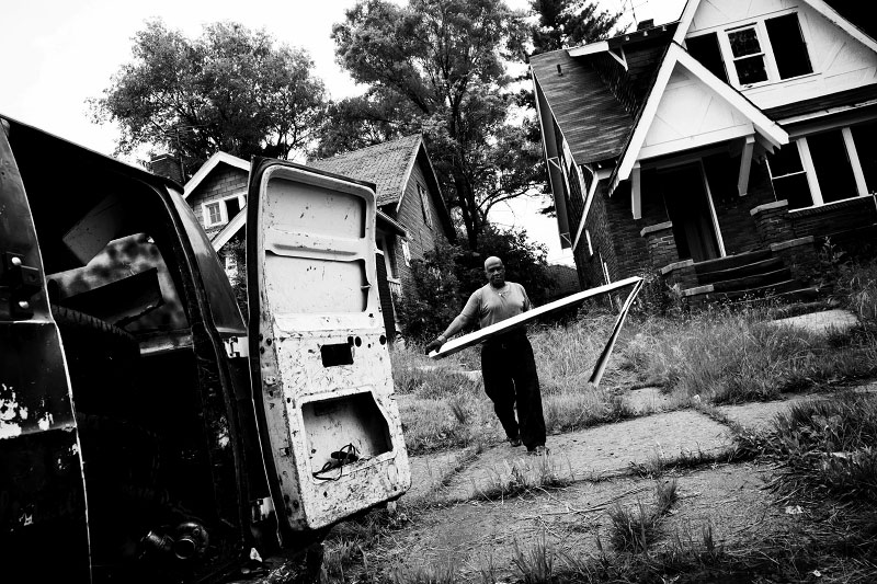 A man retrieves metal from an abandoned house. Although it is illegal, this activity has been thriving as a sort of business in Detroit, since nearly nobody cares such abandoned houses and as job opportunities are very limited, due to the economic downturn.