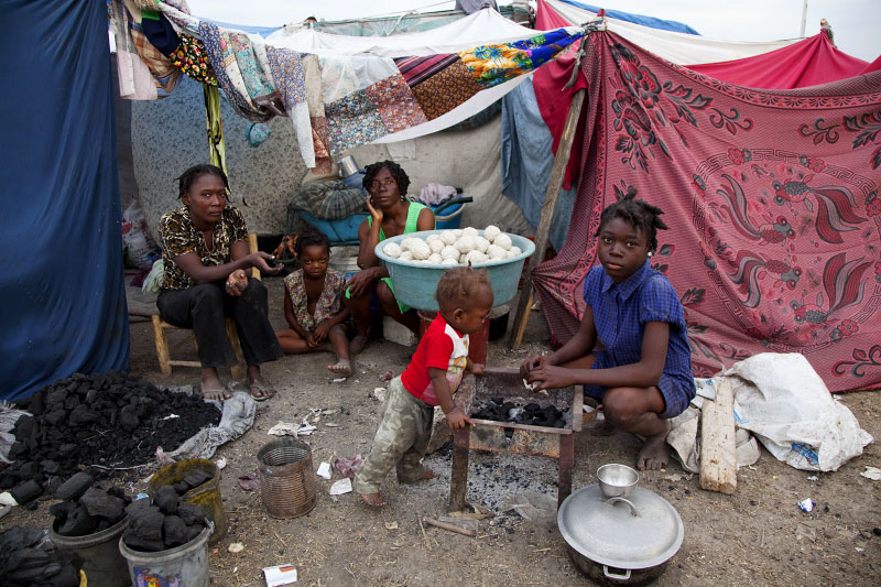 At Pont-Rouge refugee camp, Haitian earthquake IDP family, from the right, Widline Brezil, 11, Joseph, one year old baby, Ivrose, 39, Rosemita, 5, and Geurline, 28, stay inside their tent. Ivrose lost her brother due to the January 12th quake.