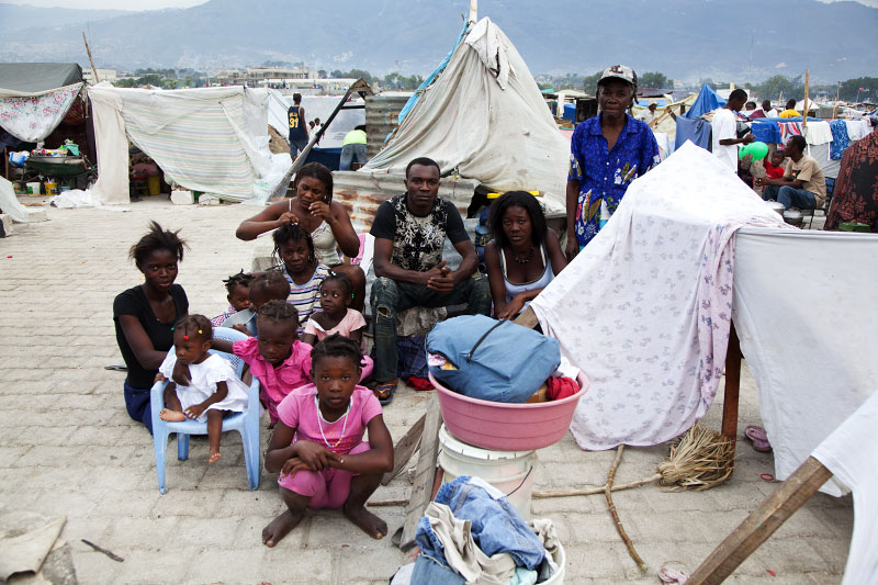 At Pont-Rouge refugee camp, a big Haitian earthquake IDP family of Dormevil Tot, 28, stay in front of their tent where 12 people live together. Fortunately they didn't lose anyone due to the January 12th earthquake.