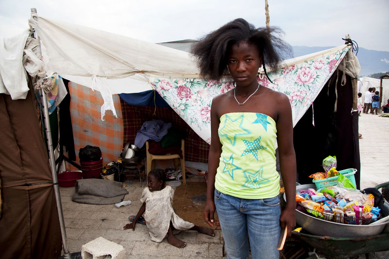 At Pont-Rouge refugee camp, a Haitian earthquake IDP Baby Fleuranvil, 18, and her 7 year old sister Flaurancia stay at their tent where five people live together. Fortunately they didn't lose anyone due to the January 12th earthquake.