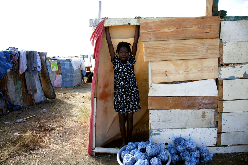 At Pont-Rouge refugee camp, 12 year old Haitian earthquake survivor Vanessa Alfronse stays at her tent where 5 family members live together.