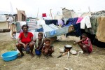 At Pont-Rouge refugee camp, Haitian earthquake IDP family, from the left, Vuergeme Fredric, 48, Jean Jacob, 8, Jean Rosena, 5, and Jean Lovelie, 9, stay at their tent where 9 family members live together. Vuergeme lost her mother, brother and two sons due to the January 12th quake.