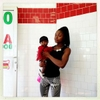 At the Corner: Shay, 23 with her baby