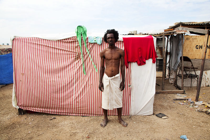 At Pone Rouge refugee camp, Apollon Ralpho, 30 year old Haitian quake survivor, stays in front of his shelter where he and 6 other family members live together. He lost his uncle due to the January 12th quake.