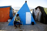 At Pont-Rouge refugee camp, 17 year old Haitian earthquake survivor Thfrere Jean stays at his tent where 8 family members live together. He lost his uncle due to the quake.