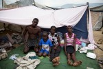 At Pont-Rouge refugee camp, Haitian earthquake IDP family, from the left, Wilvik Vakena, 29, Ifinder, 7, Metnise, 15, and Maciani, 46, stay inside their tent. Maciani lost her husband, daughter and brother due to the January 12th quake.