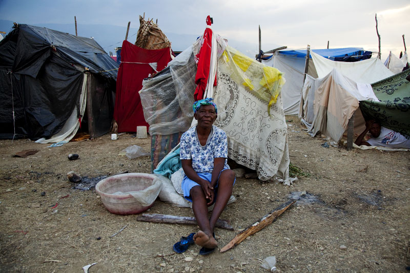 At Pont-Rouge refugee camp, 60 year old Haitian earthquake survivor Claudette Beausile stays in front of her tent where she lives alone.