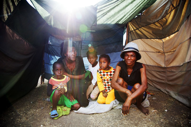 At Pont-Rouge refugee camp, Haitian earthquake IDP family, from the right, Rosette Bejamine, 50, Merline, 6, Ylvenard, 7, Audette, 47, and Jhon, 5, stay inside their tent. Rosette lost her father, husband and two children due to the January 12th quake.