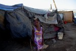 At Pont-Rouge refugee camp, 7 year old Haitian earthquake survivor Sabaline Estiven stands in front of her friend's tent.