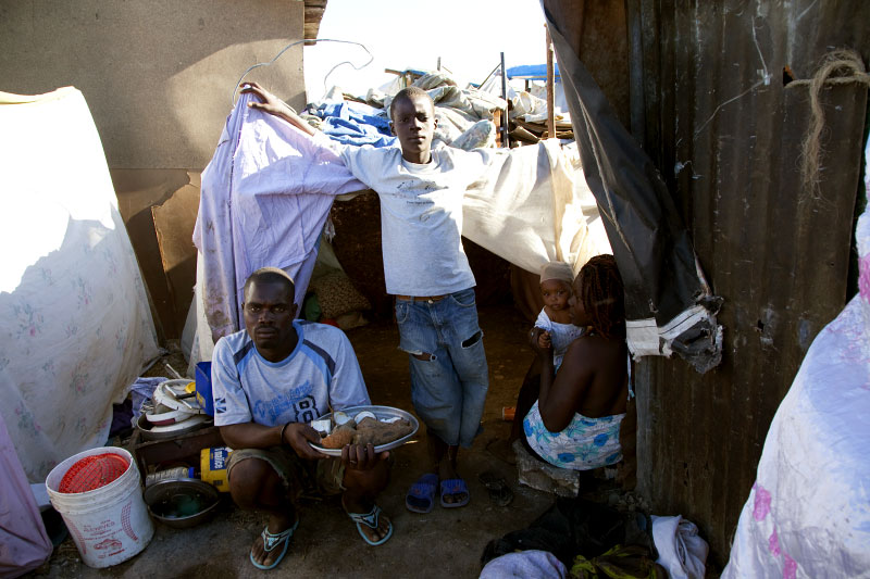 At Pont-Rouge refugee camp, Haitian earthquake survivors, from the left, Odle Charles, 28, his 13 year old son Jameson Clairejo, 6 month old baby Darken Love Charles, and its 19 year old mother Marie Michelle stay at their tent. They lost a reative due to the quake.