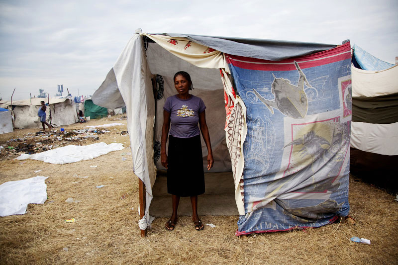 At Pont-Rouge refugee camp, Clautile Noel, 39 year old Haitian earthquake IDP, stands in front of her tent where she and her son live together. She lost her daughter due to the January 12th quake.