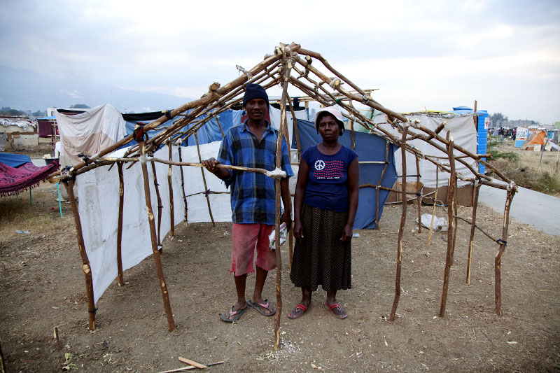 At Pont-Rouge refugee camp, 36 year old Haitian earthquake survivor Bourdo Etienne and his 48 year old wife Denise stay at their still working shelter where 3 family members live together. They lost two cousins due to the January 12th quake.