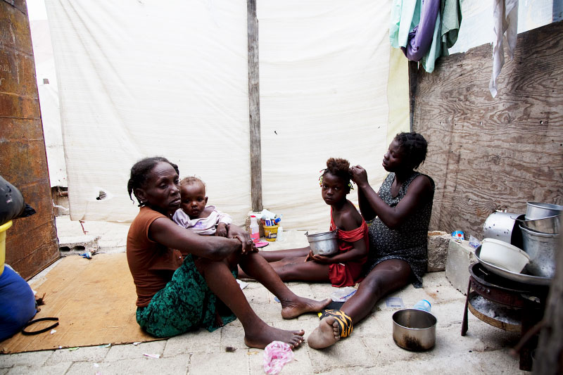 At Pont-Rouge refugee camp, Haitian earthquake IDP family, from the left, Roseline Etienne, 50, Wadline, 1 month, Regina, 8, and Leoger, 24, stay inside their tent. Leoger lost her father due to the January 12th quake.